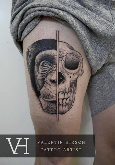 Old looking dot style thigh tattoo by Valentin Hirsch of split monkey head and skull