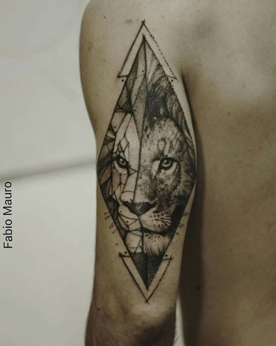 Old looking dot style upper arm tattoo of lion portrait
