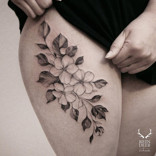 Old looking painted by Zihwa thigh tattoo of nice flowers