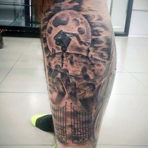 Old monster cartoon themed black ink leg tattoo stylized with cemetery