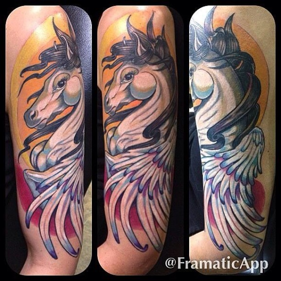 Old picture like colored shoulder tattoo of pegasus horse