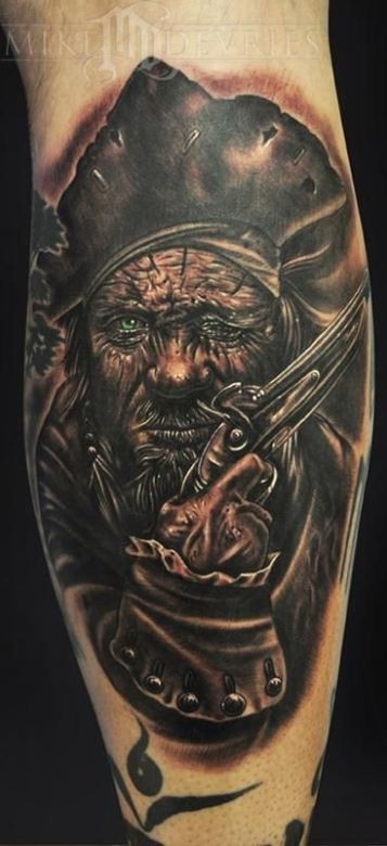 Old pirate in a cocked hat tattoo on  leg by mike devries