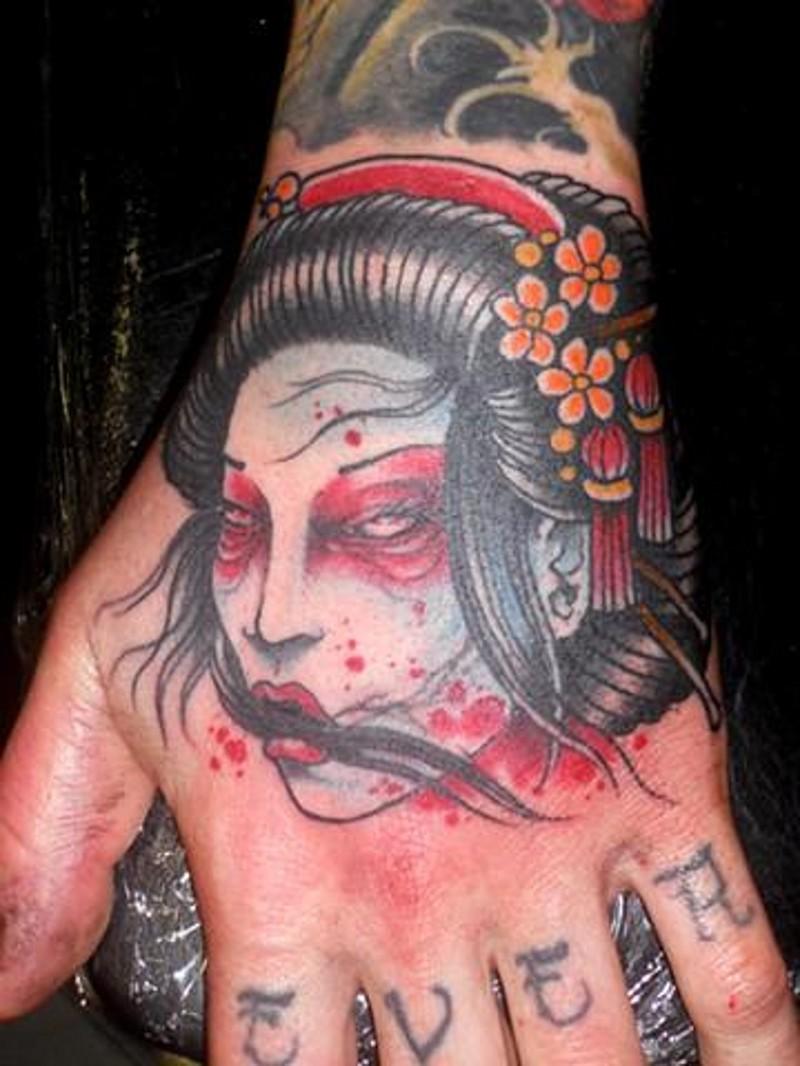 Old school Asian style little hand tattoo of geisha severed head