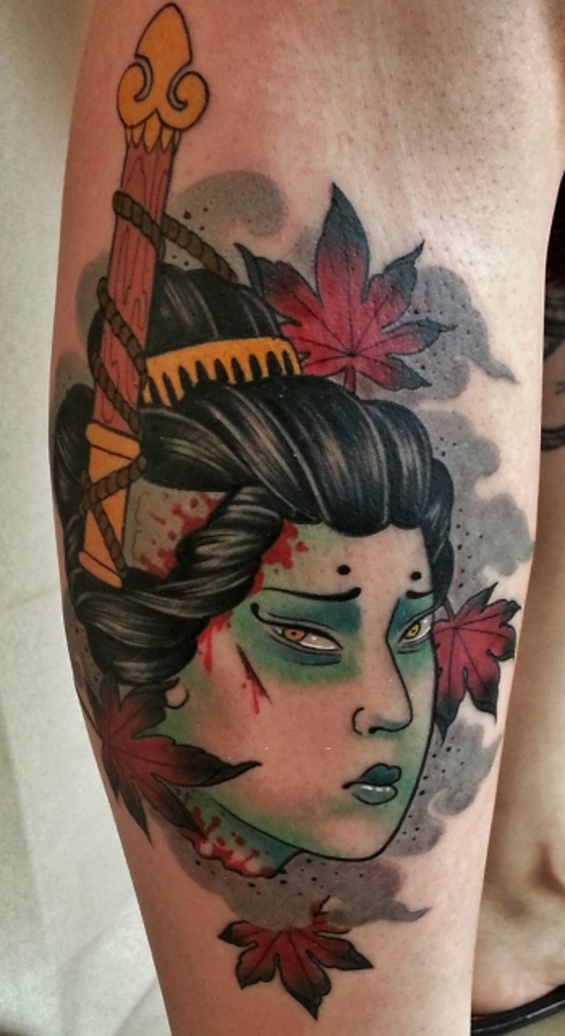 Old school big colored leg tattoo of Asian woman face