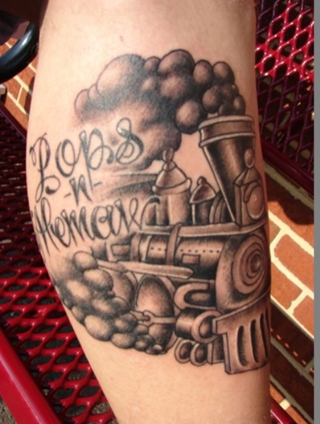 Old school black and gray style train tattoo on leg with lettering