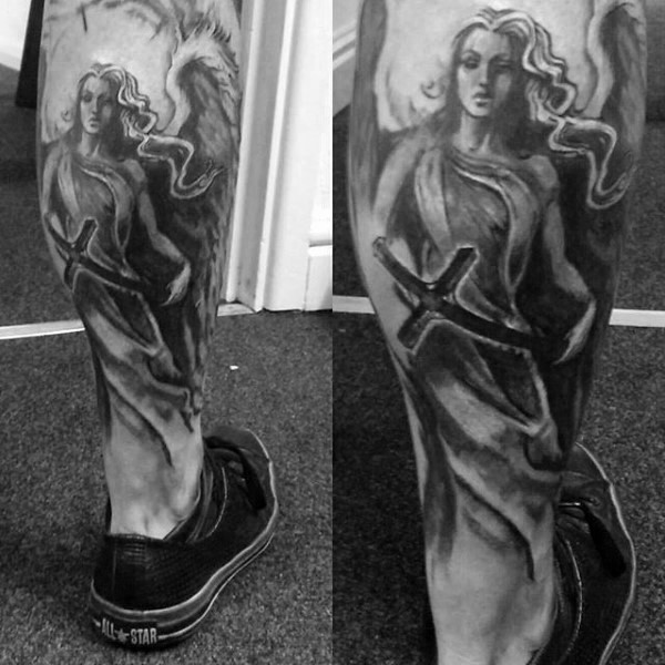 Old school black and white angel tattoo on leg with black cross