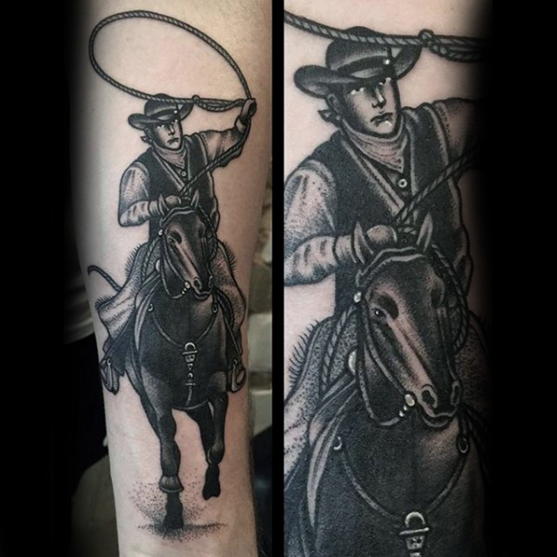 Old school black and white cowboy with horse tattoo on arm