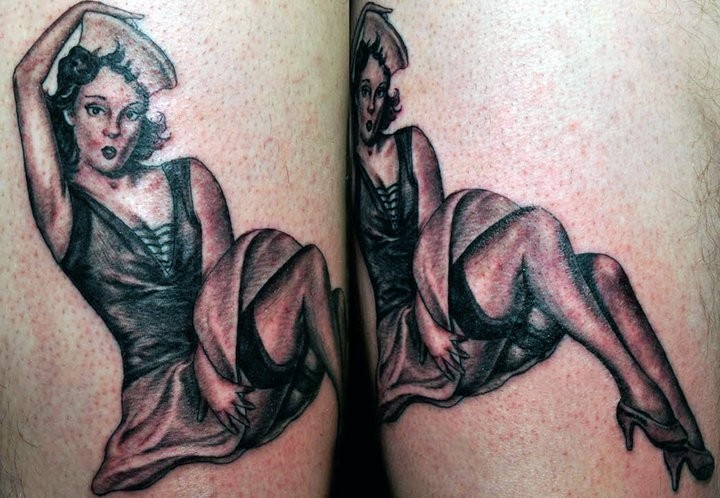 Old school black and white sailor woman tattoo on leg