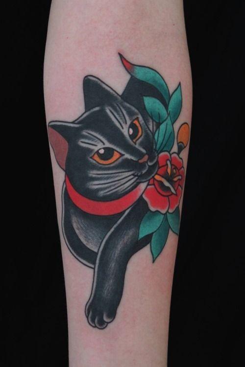 vecchia scuola gato nero con fiocco rosso tatuaggio