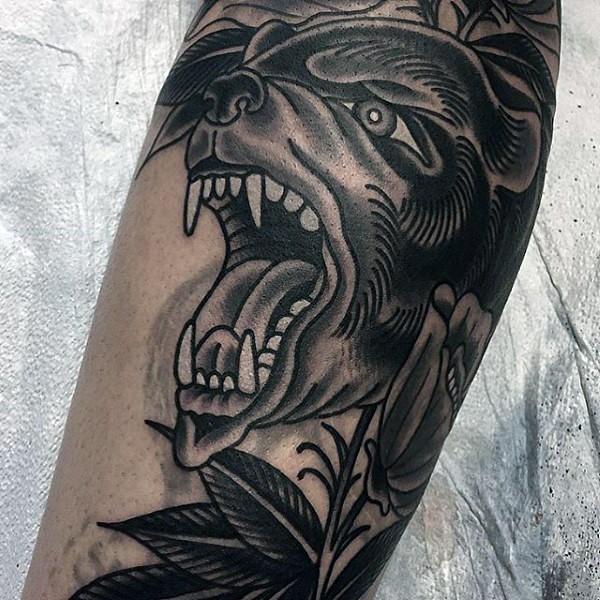 Old school black ink bear head tattoo on leg