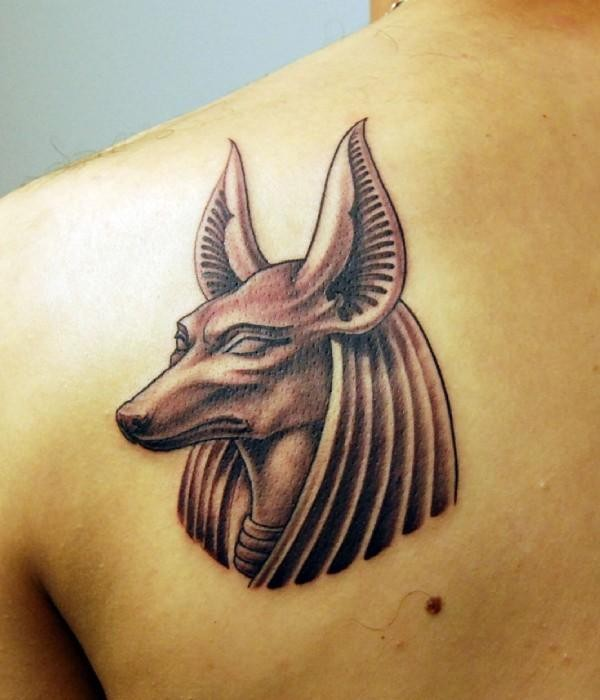 Old school black ink little back tattoo of Anubis God statue head