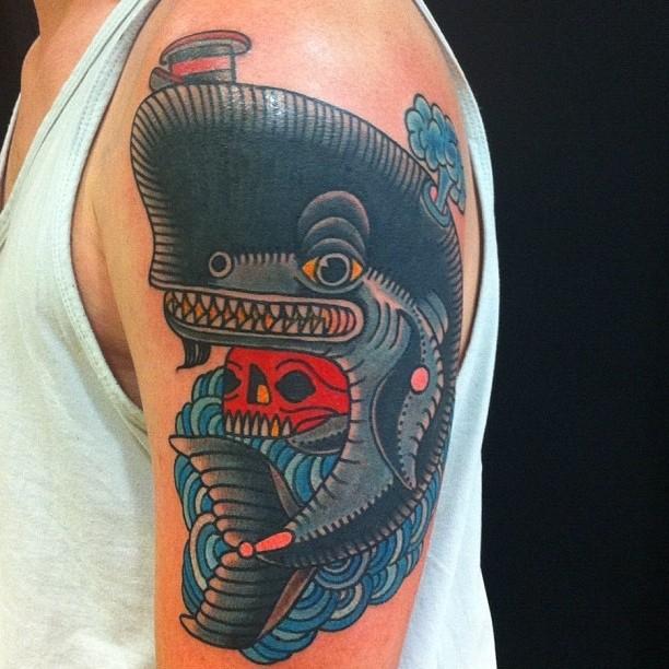 Tatuaje en el brazo, ballena y cráneo rojo, dibujo en estilo de vieja escuela