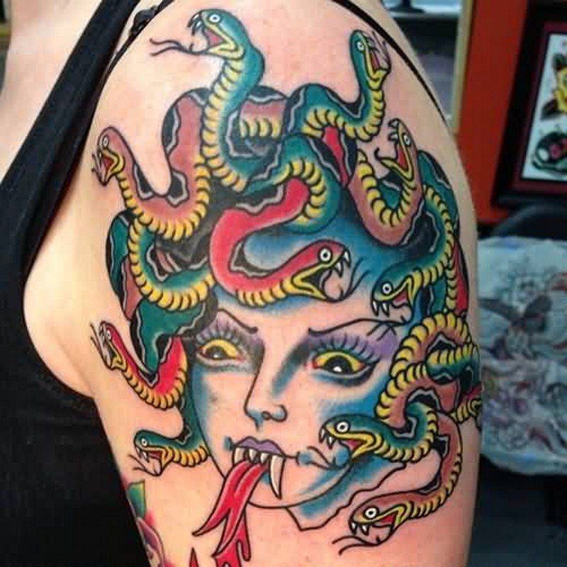 Old school carelessly painted shoulder tattoo on Medusa head with snakes