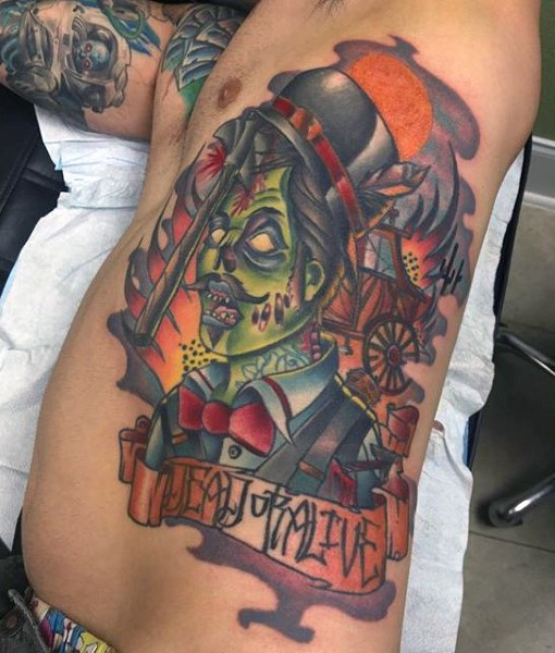 Old school cartoon like colored zombie tattoo on side with lettering