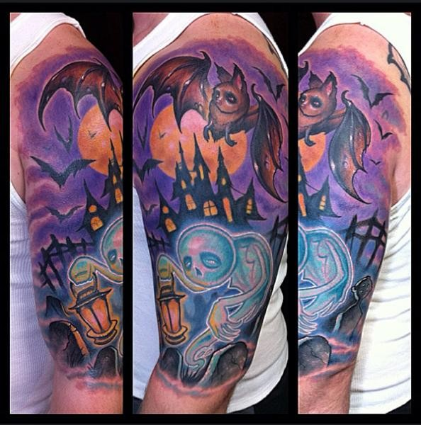 Old school cartoons style colored on shoulder tattoo of ghost and cemetery with bats