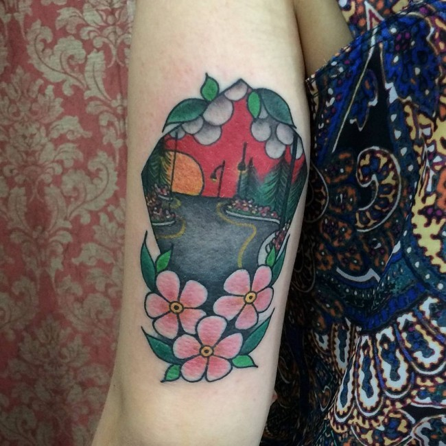 Old school colored arm tattoo of night street stylized with flowers