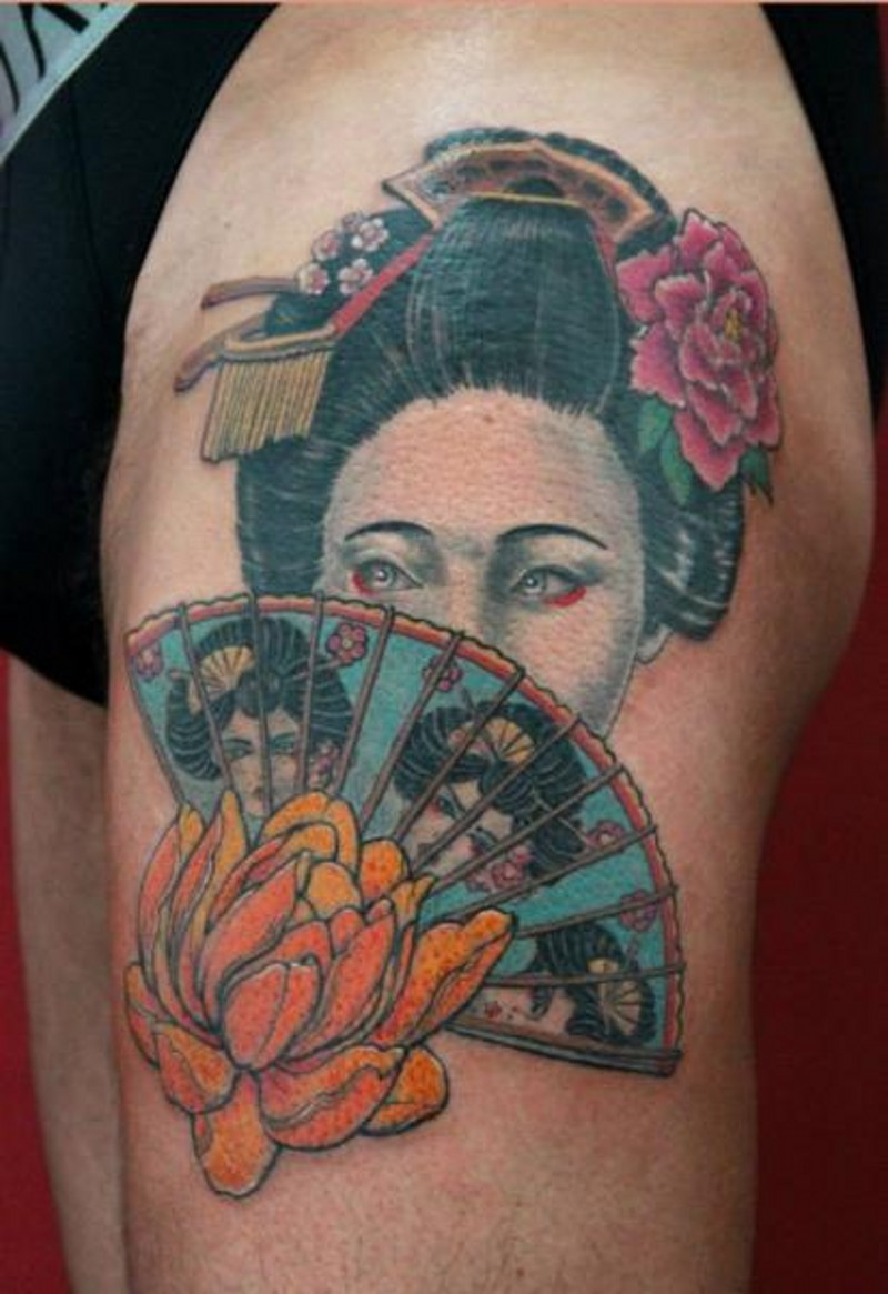 Old school colored Asian woman portrait tattoo on thigh with fan and flowers