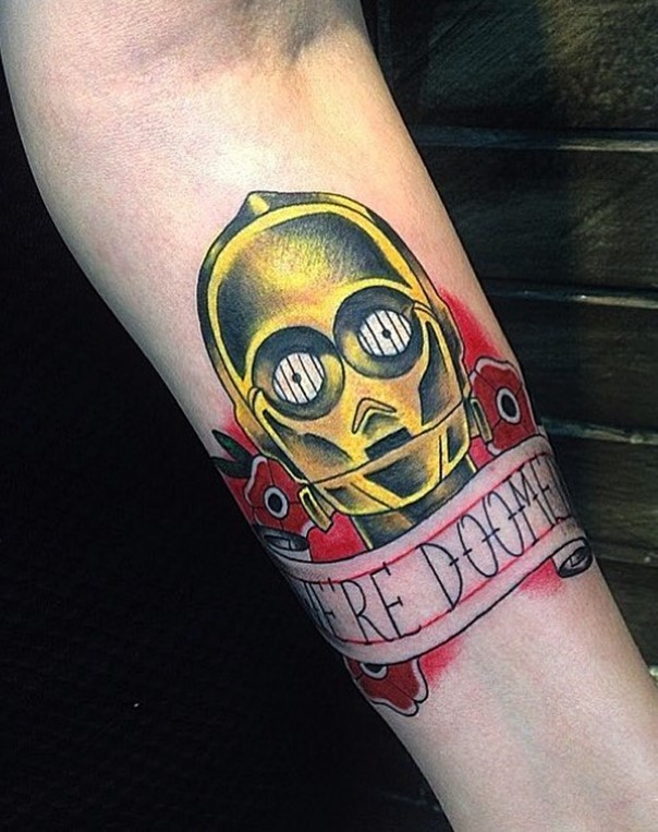 Old school colored C3PO tattoo on forearm with flowers and lettering