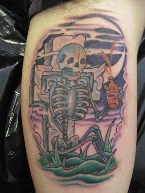 Old school colored drinking skeleton tattoo on arm with tomb stone
