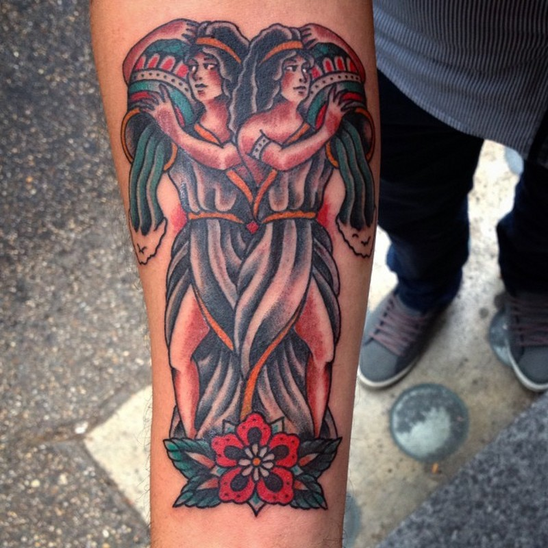 Old school colored forearm tattoo of Aquarius woman couple with flowers
