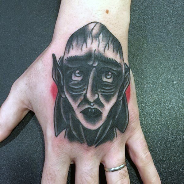 Old school colored funny Count Dracula&quots portrait tattoo on hand