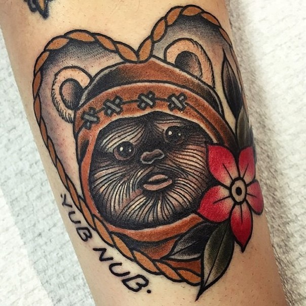 Old school colored heart shaped little Star wars hero tattoo on arm with lettering