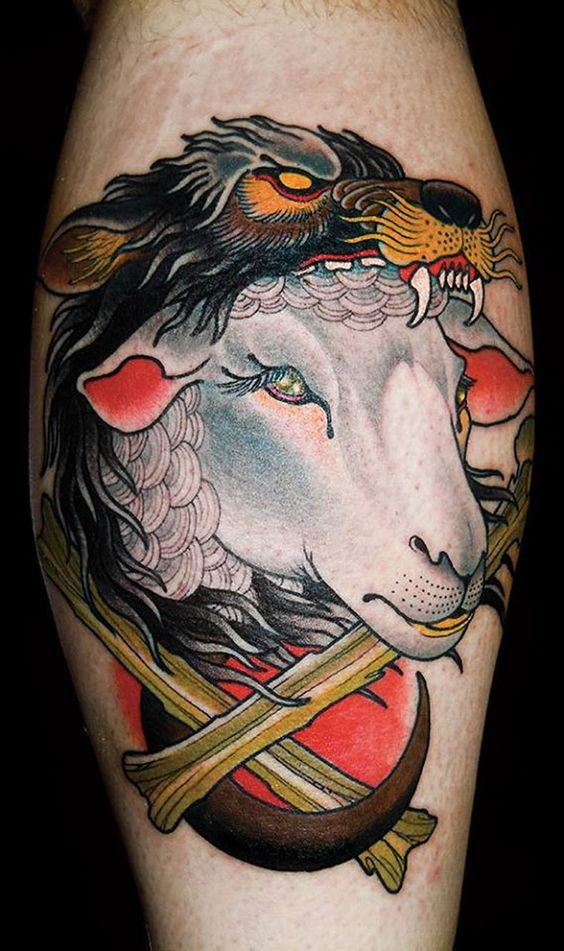 Old school colored leg tattoo of sheep with helmet from wolfs skin
