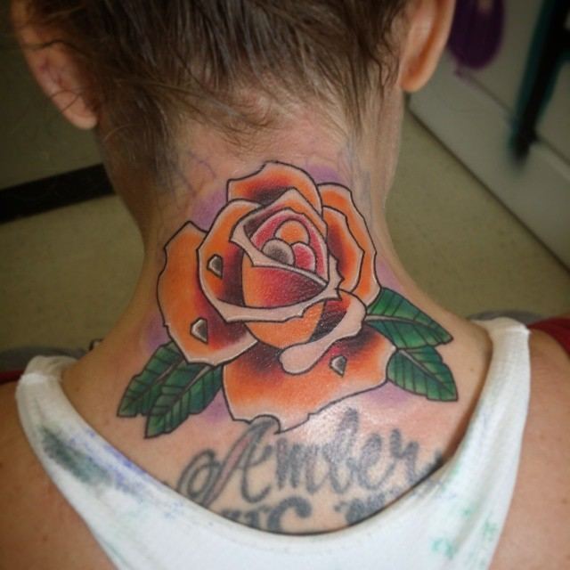 Old school colored little rose flower tattoo on neck