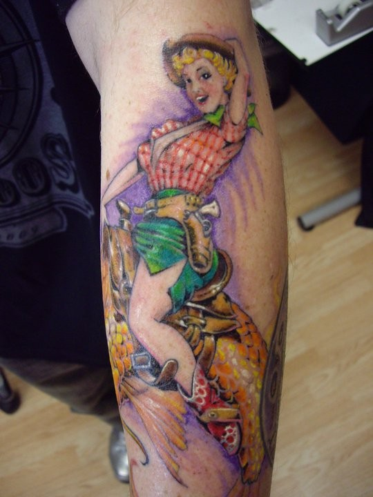 Old school colored sexy girl on golden fish tattoo on leg