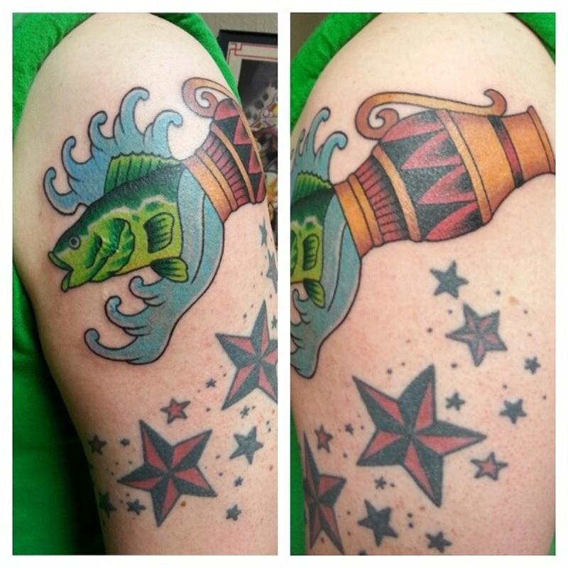 Old school colored shoulder tattoo of Aquarius symbol with stars