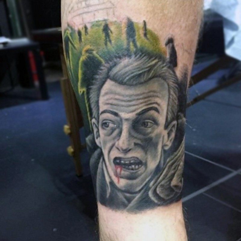Old school colored strange tattoo on leg with bloody man