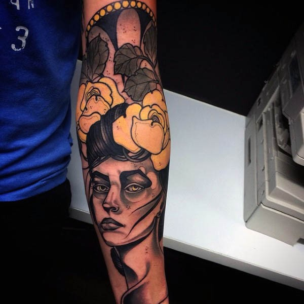 Old school colored woman portrait tattoo on forearm with yellow flowers