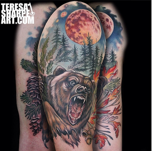 Old school colorful shoulder tattoo of roaring bear in wild forest