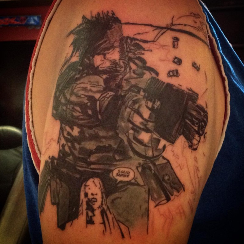 Old school comic book video game Snake hero tattoo on shoulder