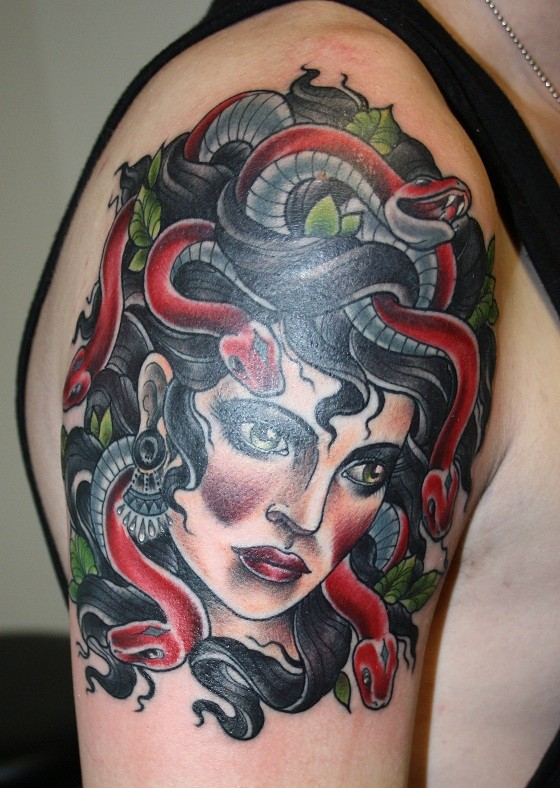 Old school cool colored forearm tattoo of Medusa with snakes portrait