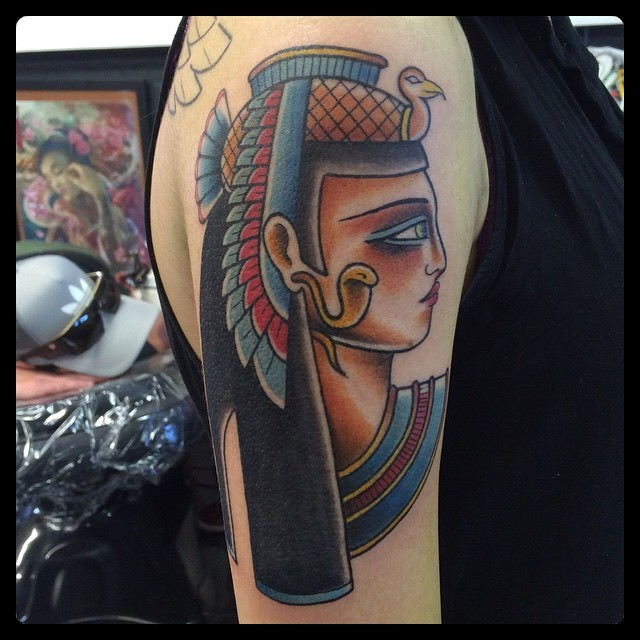 Old school Egypt traditional colored woman portrait tattoo on upper arm