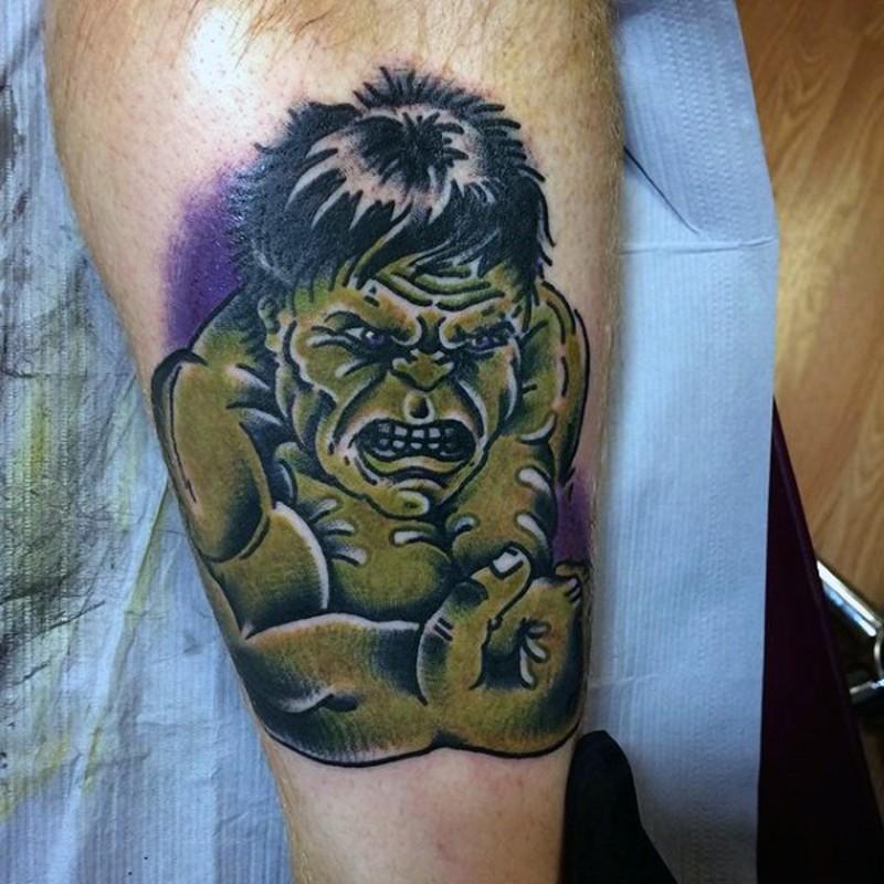 Old school funny looking colored leg tattoo of small Hulk portrait