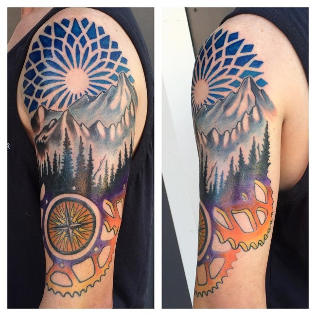 Old school half mechanical half ornamental tattoo on shoulder with mountains