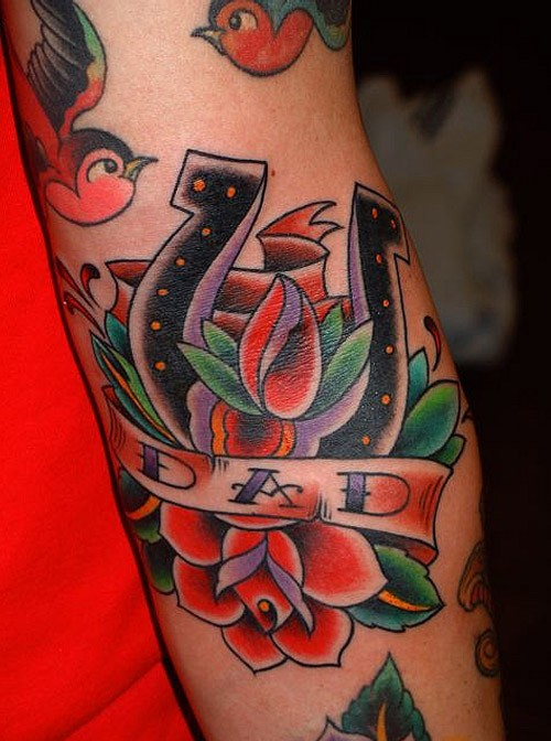 Old school horseshoe with red roses and birds tattoo