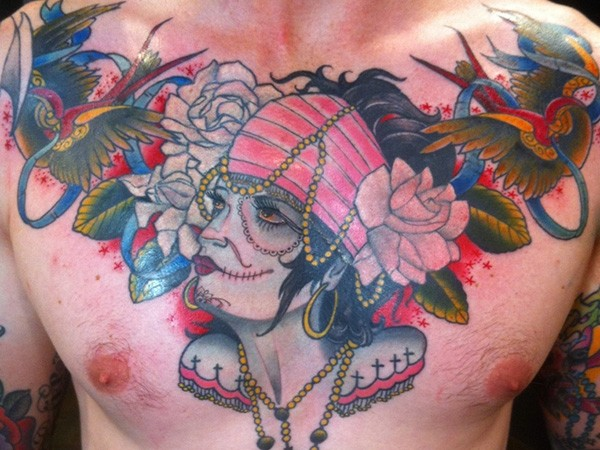 Old school Mexican native colored chest tattoo of gypsy woman with flowers and birds