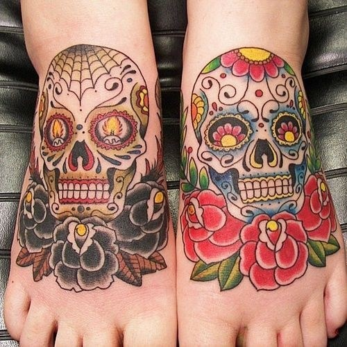 Old school Mexican traditional painted skulls tattoo on feet with roses