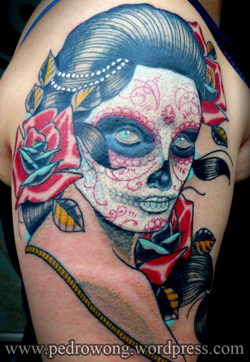 Old school Mexican traditional woman portrait tattoo on shoulder with flowers