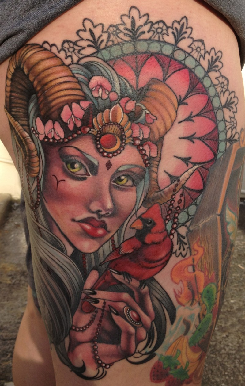 Old school multicolored devil woman tattoo on thigh combined with bird and ornamental flowers
