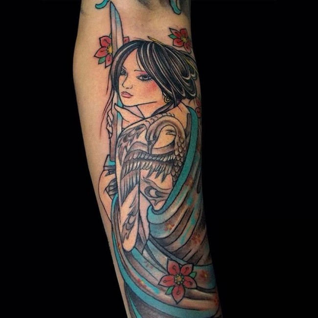 Old school multicolored forearm tattoo of beautiful Asian woman
