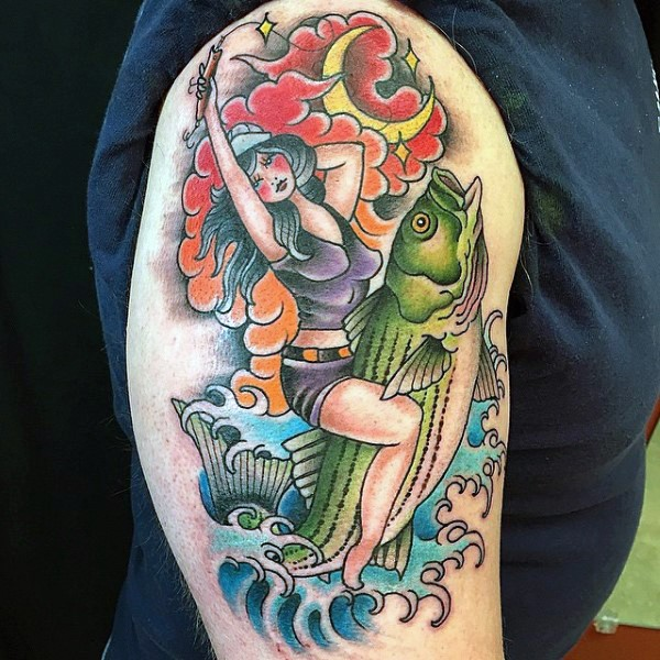Old school multicolored woman riding the fish tattoo on shoulder