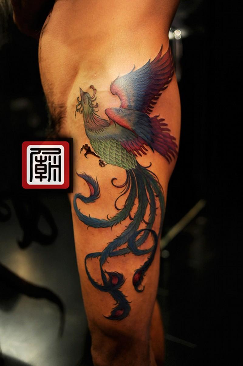 Old school painted and colored big Phoenix bird tattoo on half sleeve