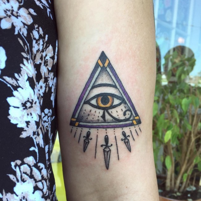 Old school painted colored forearm tattoo of triangle stylized with eye of Horus