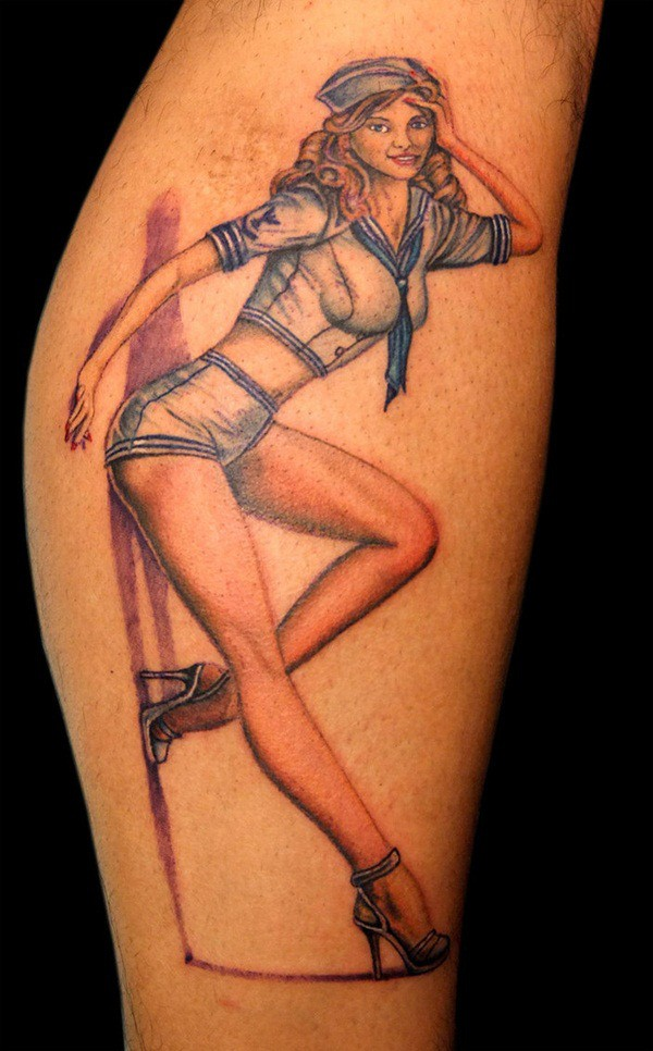 Old school painted colored pin up girl tattoo on leg - Tattooimages.biz