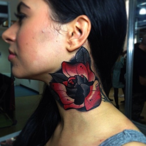 Old school red and black flower detailed neck tattoo in traditional style