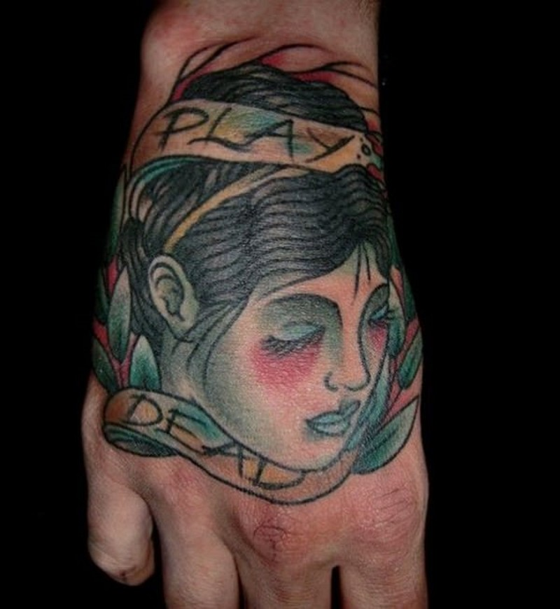 Old school simple painted hand tattoo of woman head with leaves and letteirng